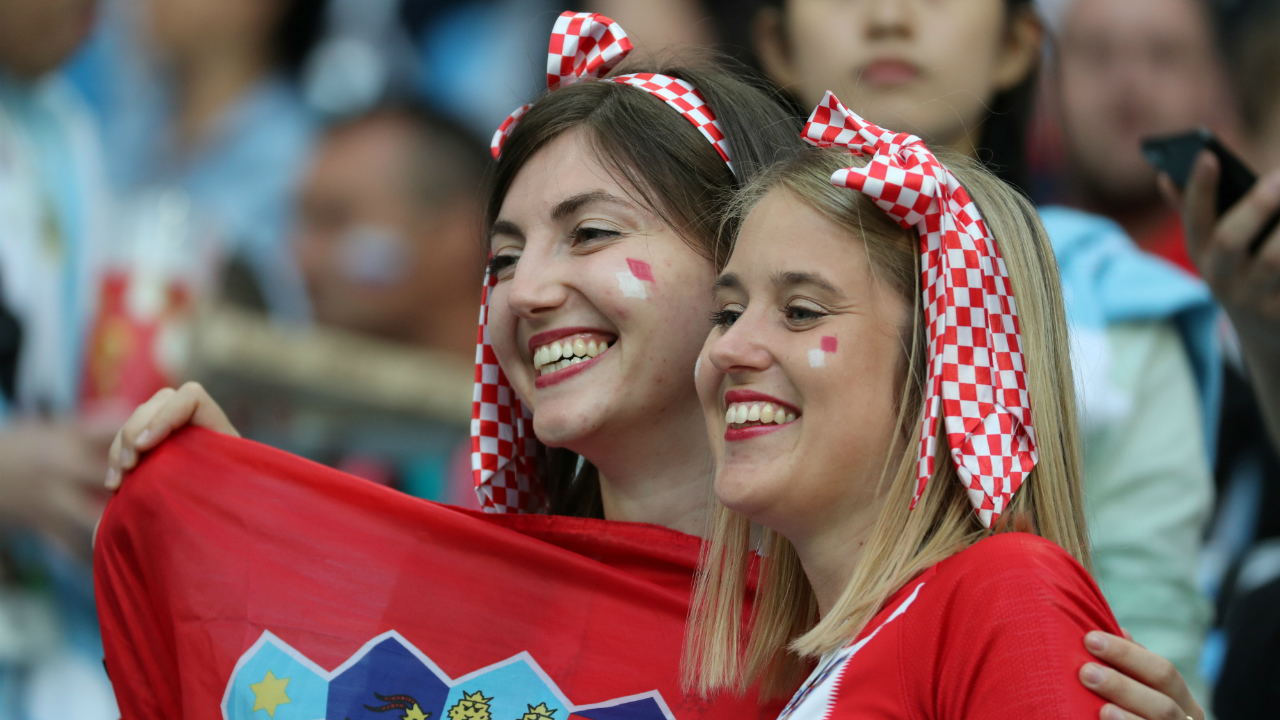 Croatian supporters pose for pictures inside the stadium before the start of the match.