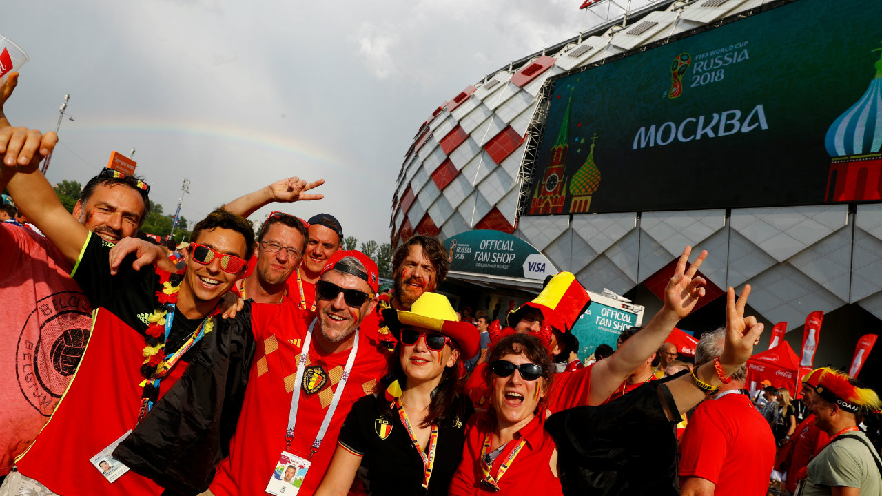 Belgium fans celebrate their team's 5-2 victory outside the stadium.