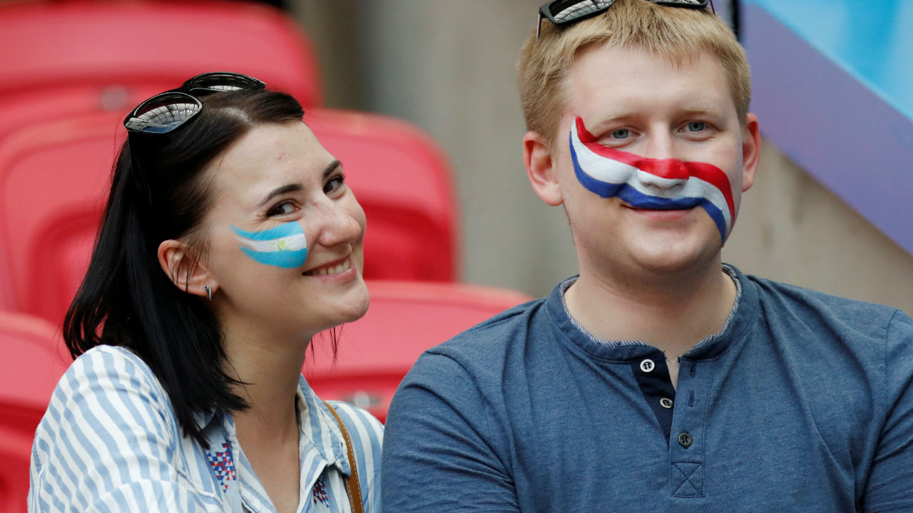 Argentina and France fans share a light moment in the stadium before the match.