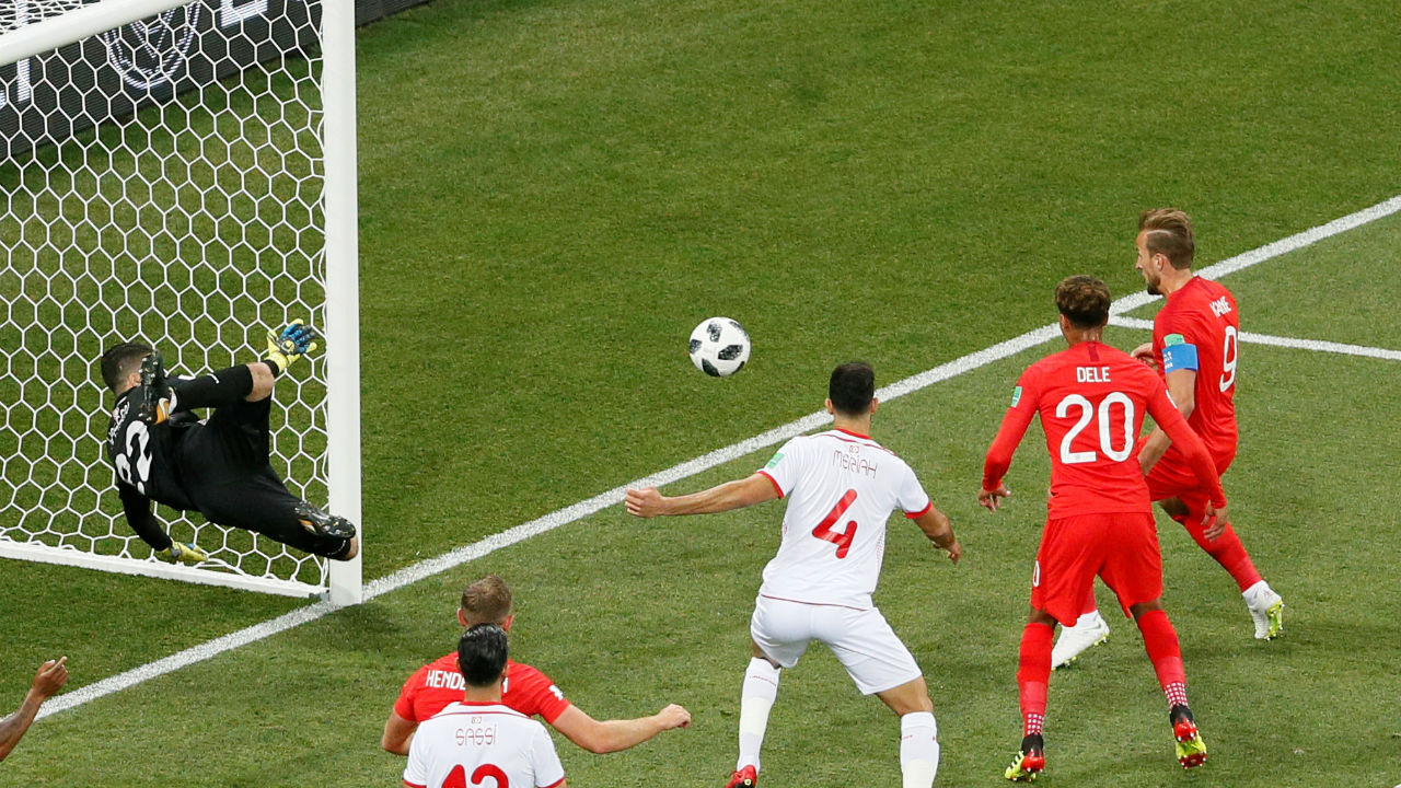 Harry Kane opened the scoring for England at the World Cup when he tapped in the rebound from John Stones' initial header towards goal. With no one to challenge him during an England corner Stones fired in a header towards goal. Tunisian keeper Hassen