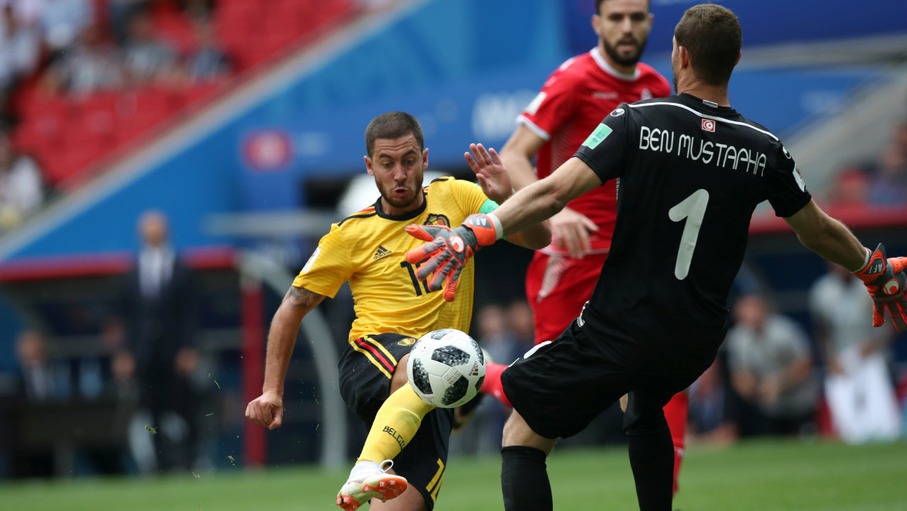 Belgium's Eden Hazard takes the ball past goalkeeper Mustapha before scoring their fourth goal.