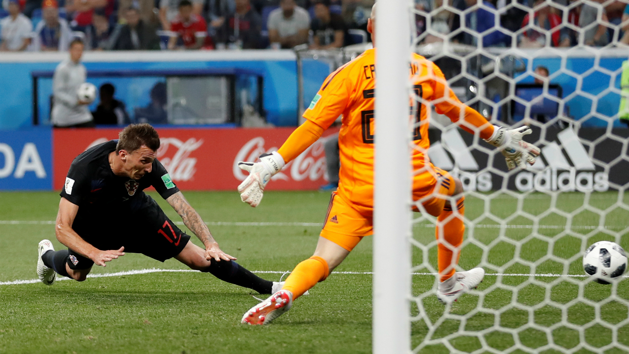 Croatia's Mario Mandzukic misses a sitter as he heads wide from close range.