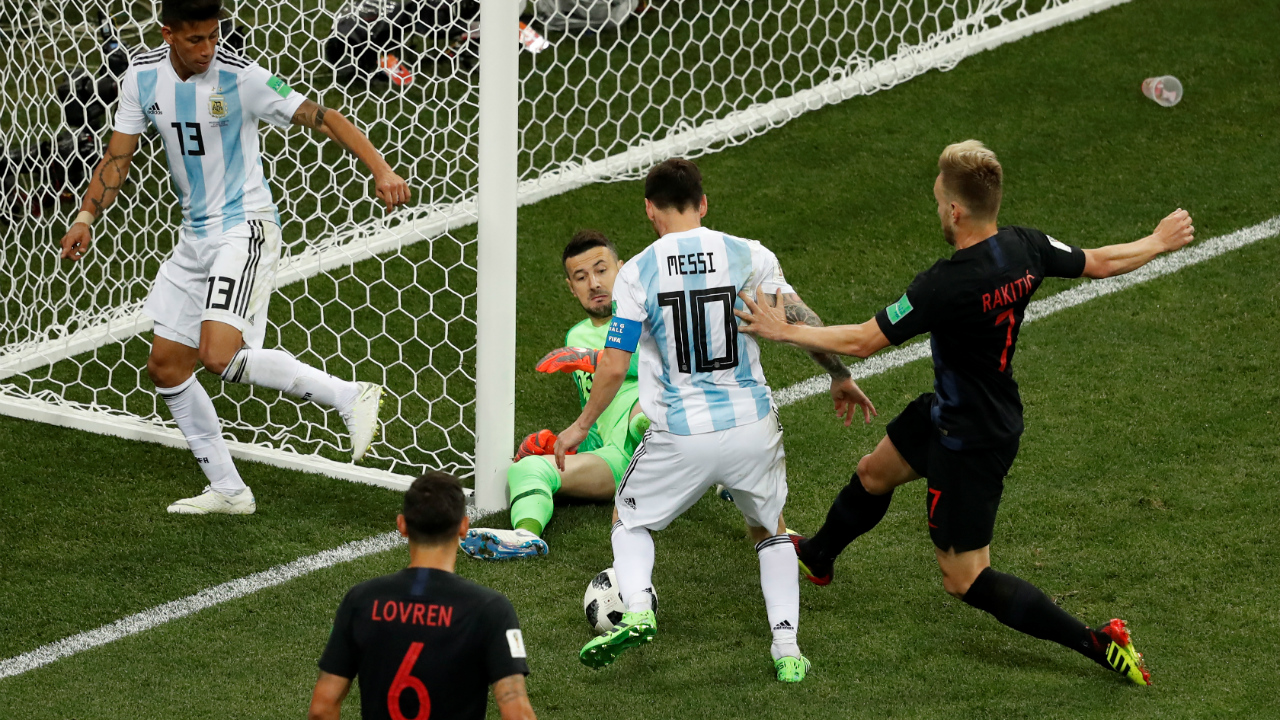 Argentina's Lionel Messi attempts to score with Croatia's Danijel Subasic and Ivan Rakitic in front of him.