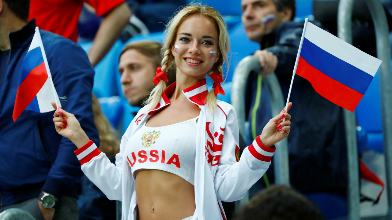 Russian fan enjoying the pre-match atmosphere inside the stadium.