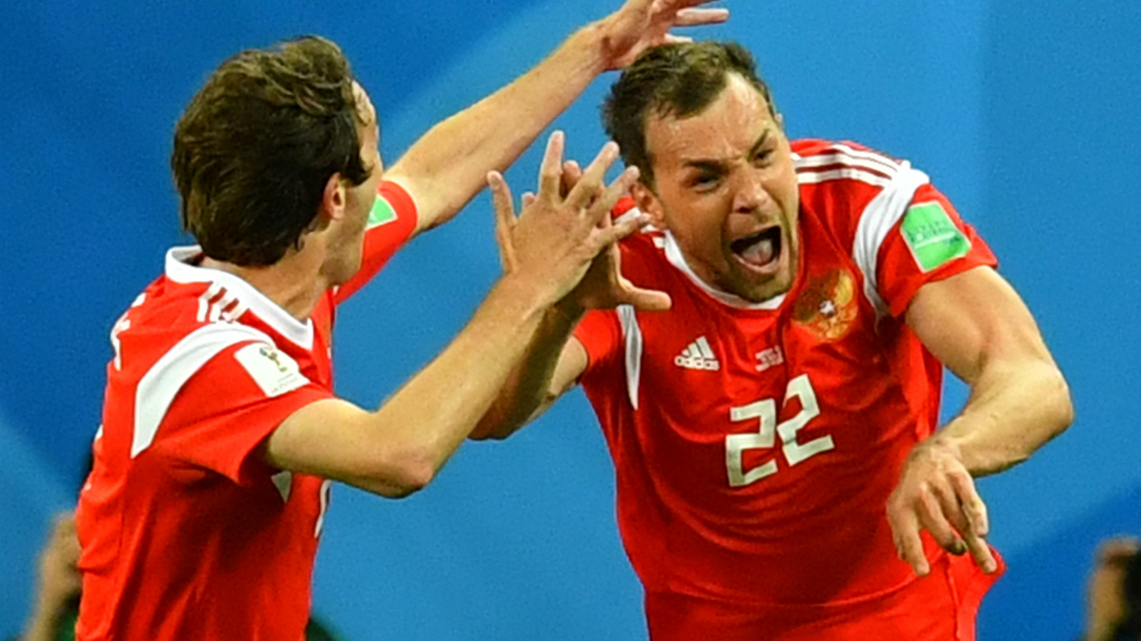 Russia's Artem Dzyuba celebrates scoring their third goal with Mario Fernandes.