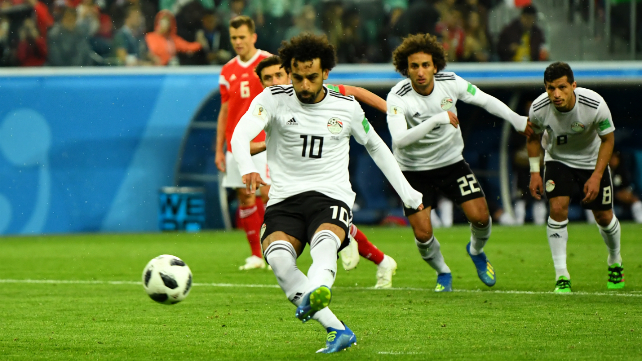Egypt's Mohamed Salah pulls one back from the penalty spot.