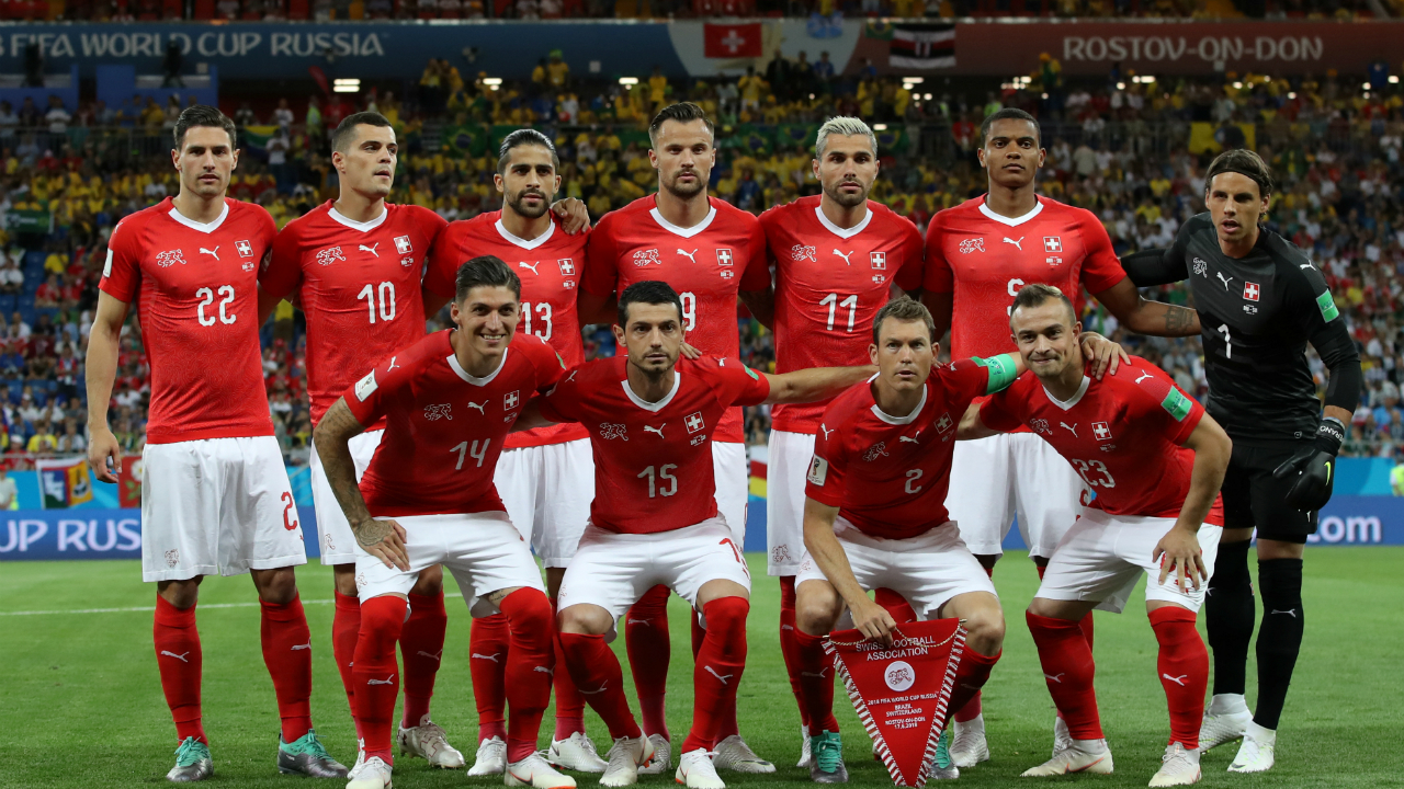 Switzerland players pose for a team group photo before the match