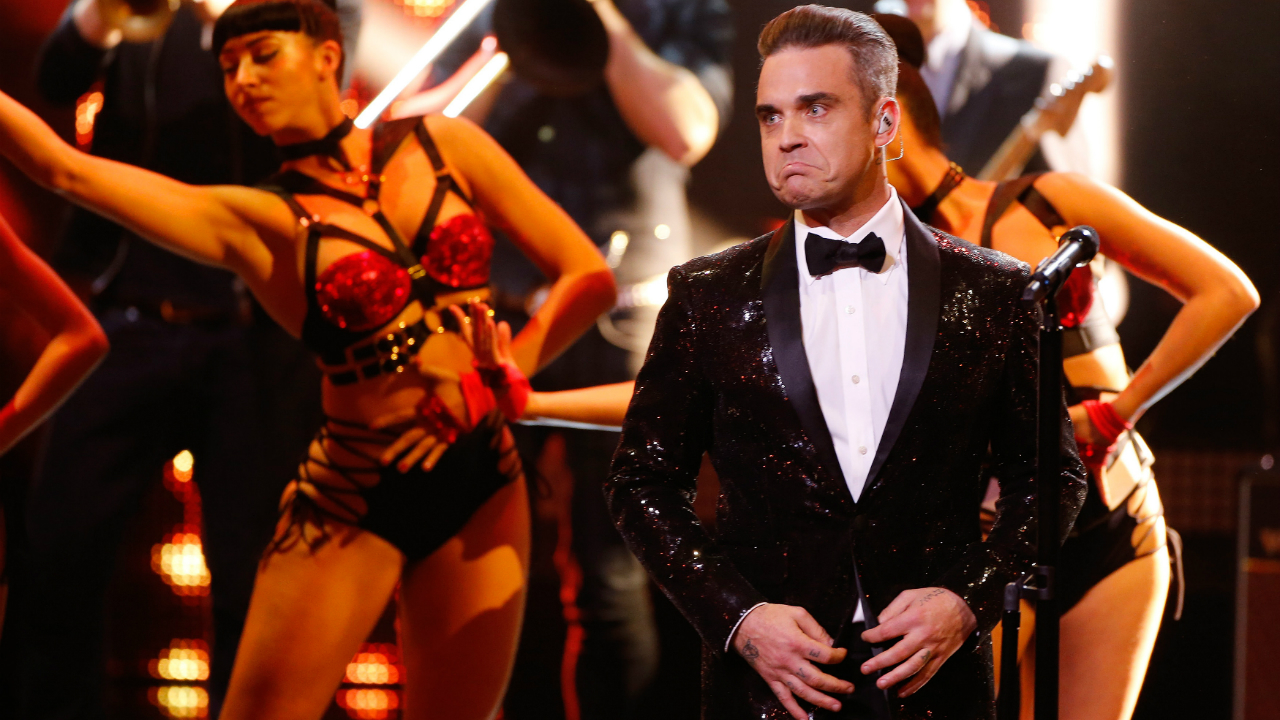 "Global music icon Robbie William who is known for his hit single ""Angels"" will be entertaining crowds at the stadium and around the world. Inviting fans to tune in to the event, Williams said in a recent interview to FIFA that it will be an, ""an unforgettable show."" (Image: Reuters)"