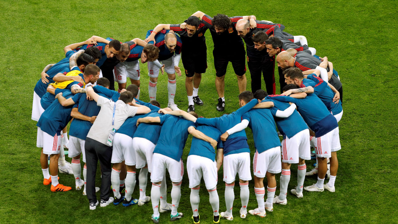 Spain team huddle during the warm up before the match.