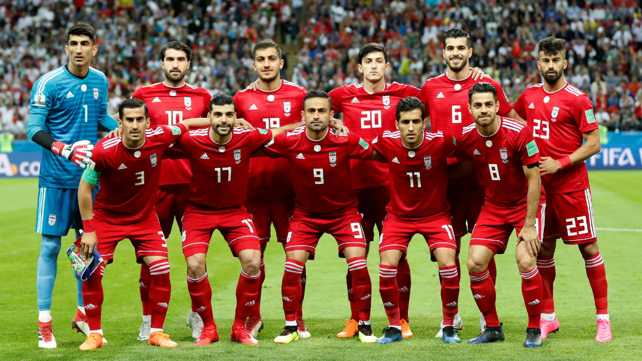 Iran players pose for a team group photo before the match.