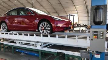 Elon Musk unveils Tesla Model 3 Performance car's new production line