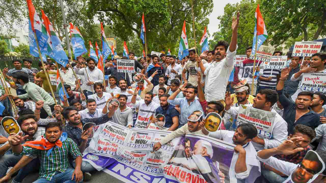 NSUI activists raise slogans against Union HRD Minister Prakash Javedkar during a protest over various issues, at Shastri Bhawan in New Delhi. (PTI)