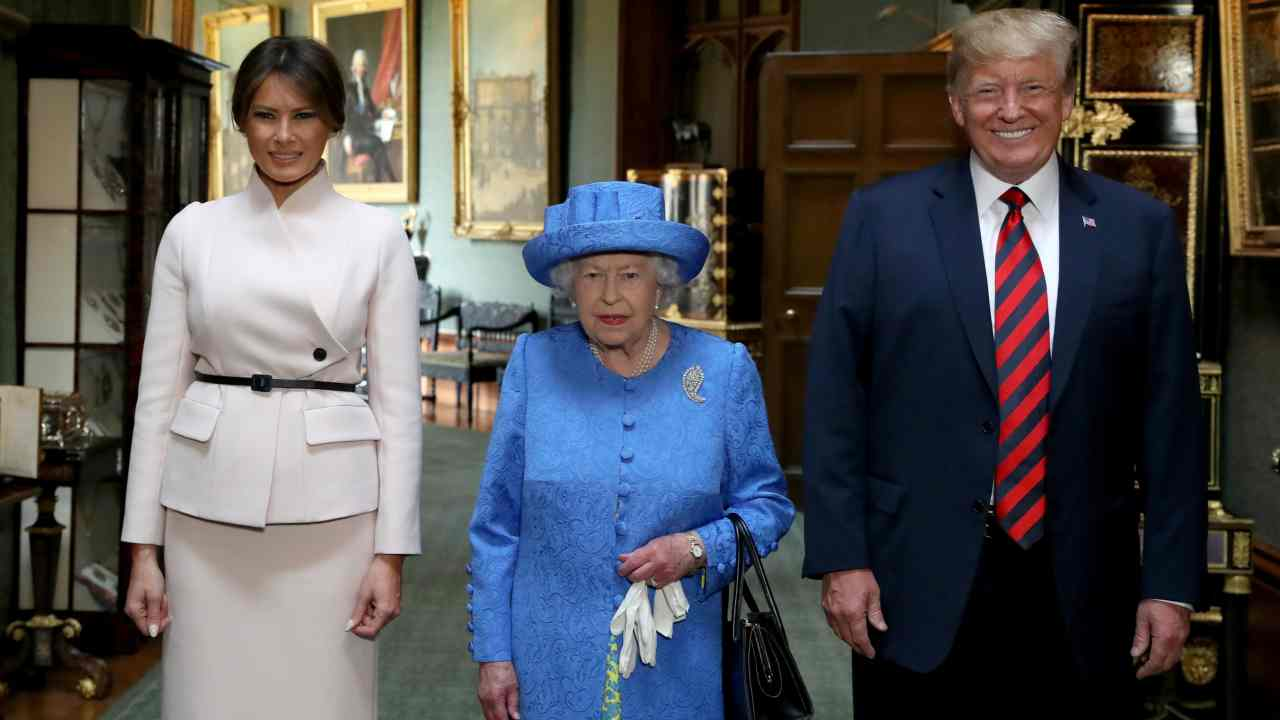 Britain's Queen Elizabeth stands with US President Donald Trump and his wife, Melania in the Grand Corridor during their visit to Windsor Castle, Windsor. (Reuters)