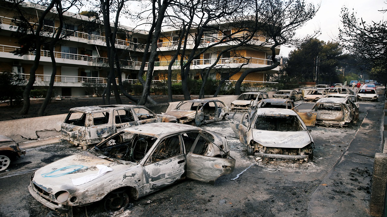 Burned cars are seen following a wildfire at the village of Mati, near Athens, Greece (Image: Reuters)
