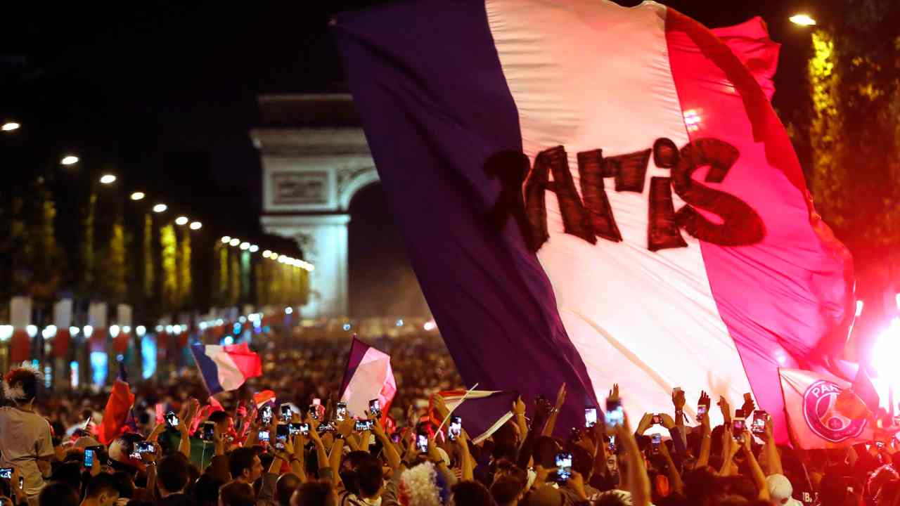 The crowd invades the Champs Elysees avenue, with the Arc de Triomphe in background, to celebrate after the semifinal match between France and Belgium at the 2018 soccer World Cup, in Paris. France advanced to the World Cup final for the first time since 2006 with a 1-0 win over Belgium. (AP/PTI)