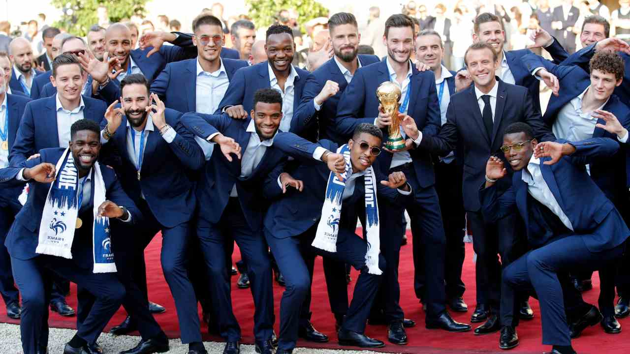 French President Emmanuel Macron, third right, poses with the French soccer players at the presidential Elysee Palace after the parade down the Champs-Elysees, where tens of thousands thronged after the team's 4-2 victory over Croatia. Holding the cup is captain Hugo Lloris. (AP/PTI)