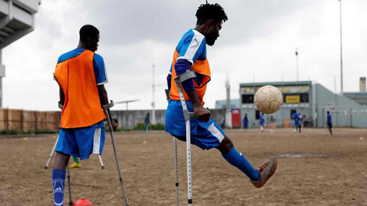 An amputee footballer on crutches plays with a ball during a training session for Nigeria's national amputee football team in a field at the national stadium in Surulere district in Lagos, Nigeria. (Reuters)