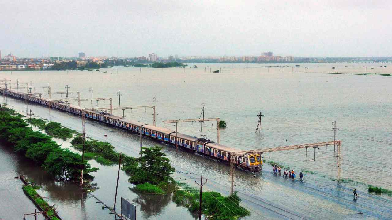 Commuters stranded on their way to Mumbai as a section of Western Raillway remain suspended due to waterlogging on tracks, after heavy rainfall at Nallasopara area, in Mumbai. (PTI)