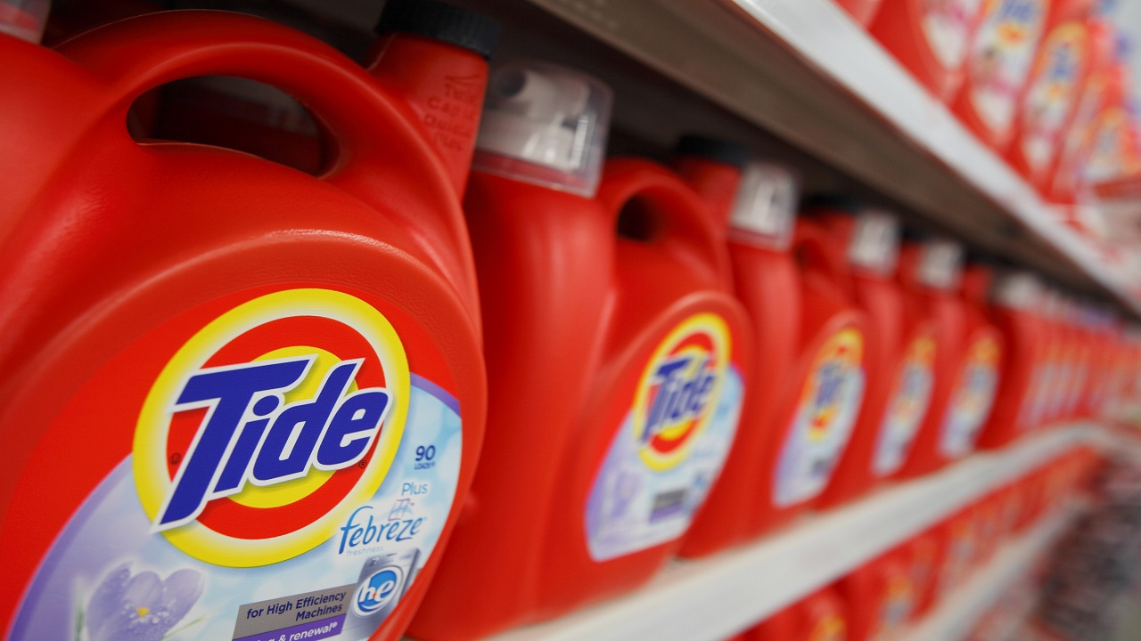 Answer: TIDE. Tide is recognized for its distinctive orange-and-yellow bulls eye logo. Tide was the first product to be nationally packaged using Day-Glo colors, strikingly eye catching when first introduced. The logo people see today was a product of a slight modification for the product's fiftieth anniversary in 1996. Currently, the Tide brand is given to over half a dozen powders and liquid detergents in the United States alone (Image:Reuters)