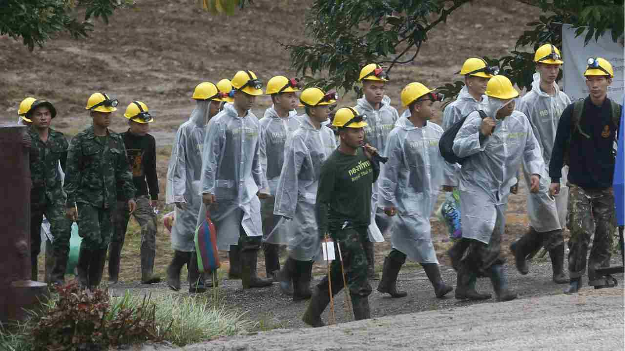 Rescuers walk toward the entrance to a cave complex where five were still trapped, in Mae Sai, Chiang Rai province, northern Thailand on Tuesday. The eight boys were rescued from the flooded cave. (AP/PTI)