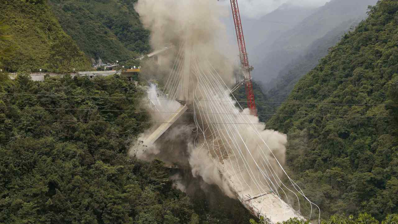 A partially-built suspension bridge is demolished by engineers in Chirajara, Colombia. One part of the bridge collapsed in January during its construction, killing at least nine workers. (AP/PTI)