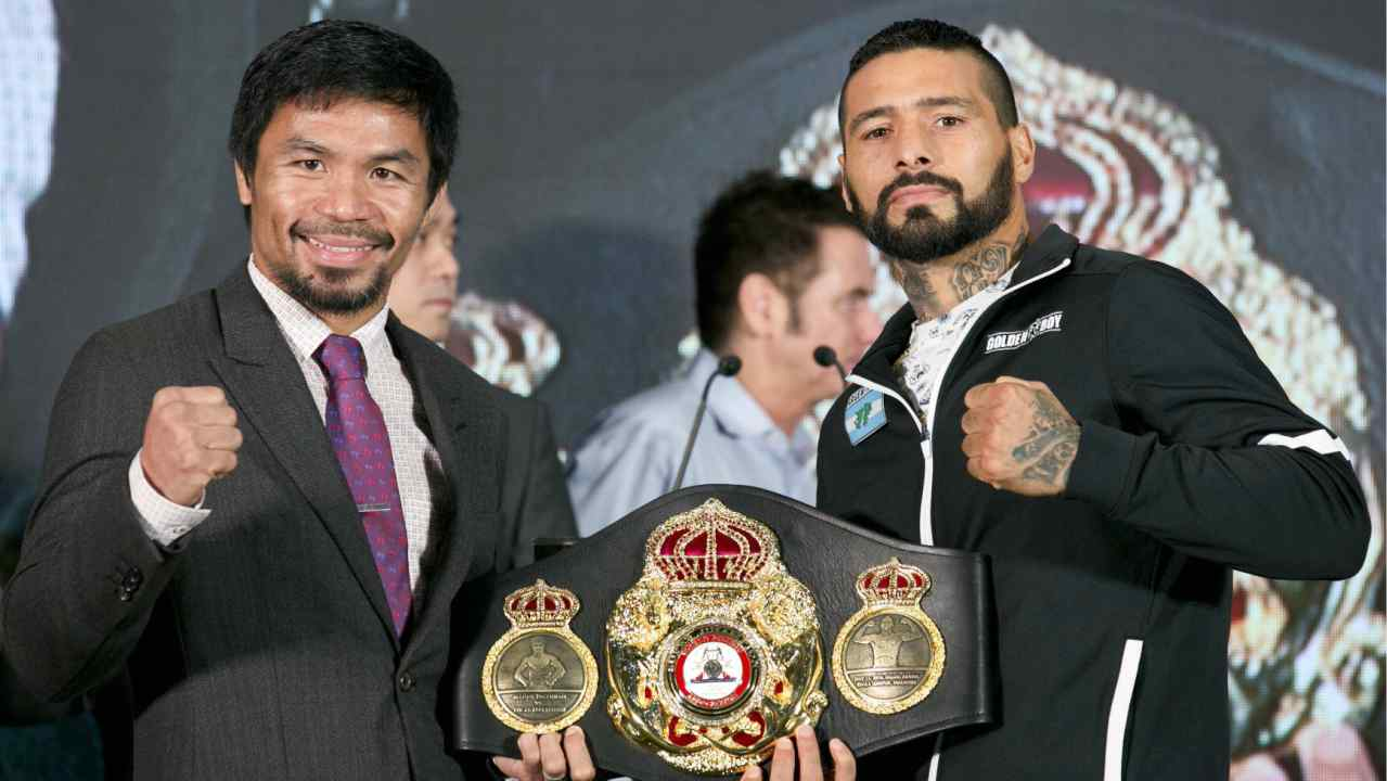 Philippine senator and boxing hero Manny Pacquiao, left, poses with Argentine WBA welterweight champion Lucas Matthysse during a press conference, in Kuala Lumpur, Malaysia. Matthysse and Pacquiao were scheduled to fight on July 15, for the World Boxing Association welterweight title in Malaysia. (AP/PTI)
