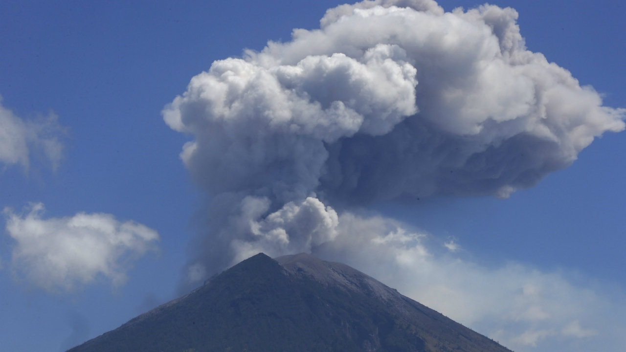 Mount Agung volcano spews ash and smoke in Karangasem, Bali, Indonesia. The volcano on the Indonesian tourist island of Bali erupted earlier this week, ejecting a 2,000-meter-high (6,560-foot-high) column of thick ash and hurling lava down its slopes. (AP/PTI)