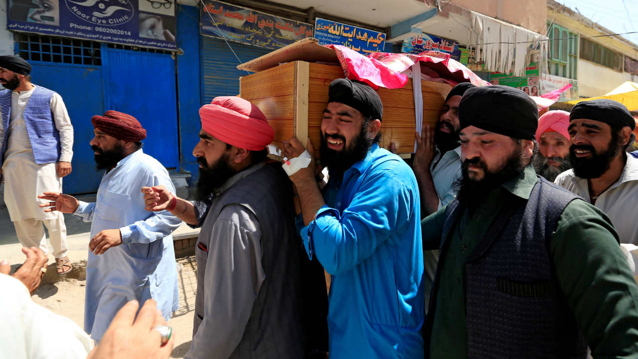 Afghan Sikh men carry the coffin of one of the victims of yesterday's blast in Jalalabad city, Afghanistan. (Reuters)