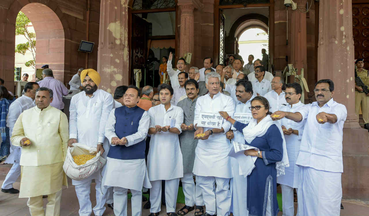Congress MPs stage a protest against the hike in the MSP (Minimum Support Price) of alternative crops, at Parliament House, on the second day of the Monsoon Session, in New Delhi on Thursday. (PTI)