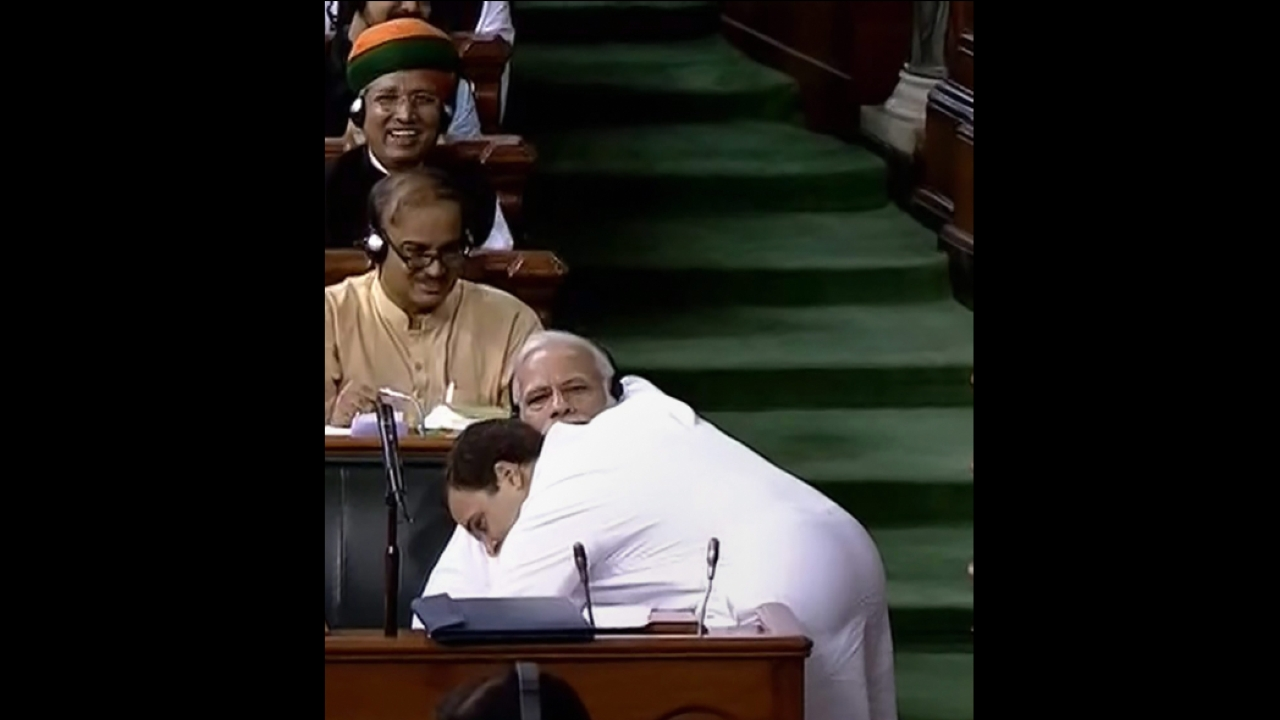 Congress President Rahul Gandhi hugs Prime Minister Narendra Modi after his speech in the Lok Sabha on 'no-confidence motion' during the Monsoon Session of Parliament, in New Delhi. (PTI)