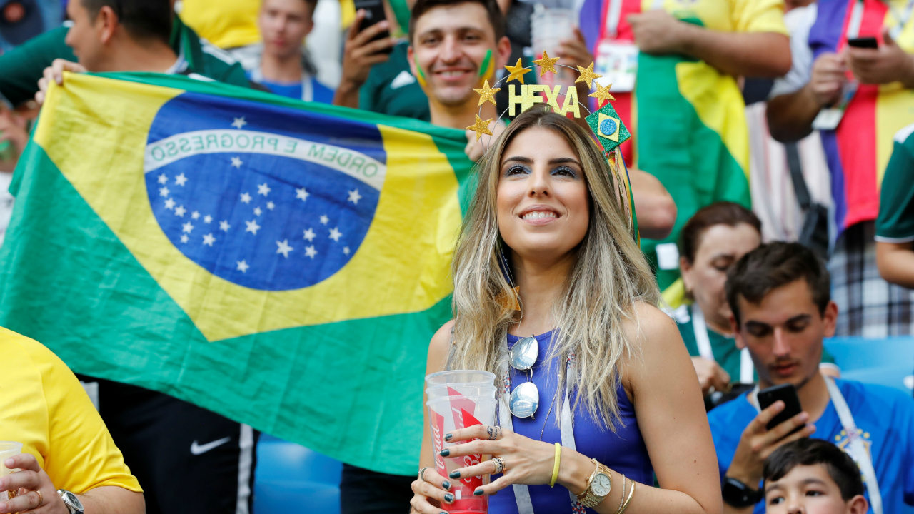 A Brazil fan, soaking in the occasion with a drink. The Brazilian fans were not to be outdone by their North American counterparts and were equally loud in their support. (Image: Reuters)