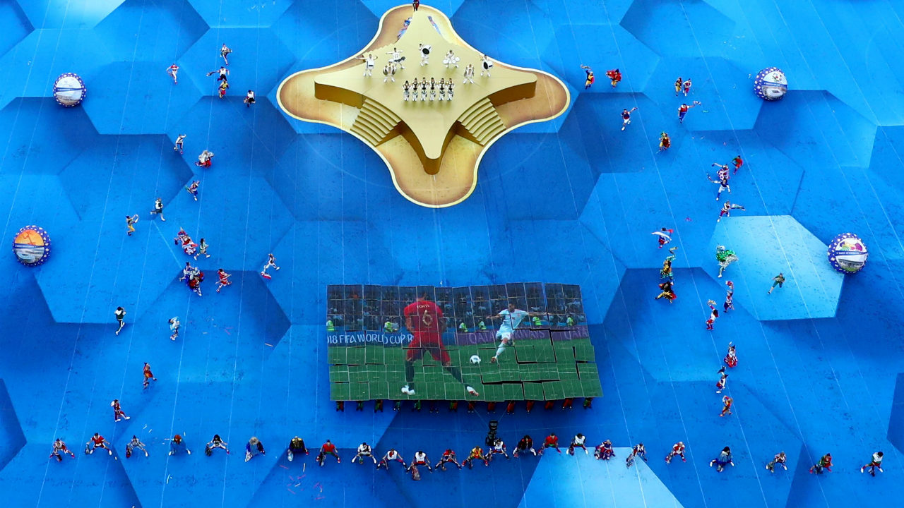 Part of the performance included dancers carrying LED screens and forming a giant screen together, to display images from the tournament. (Image: Reuters)