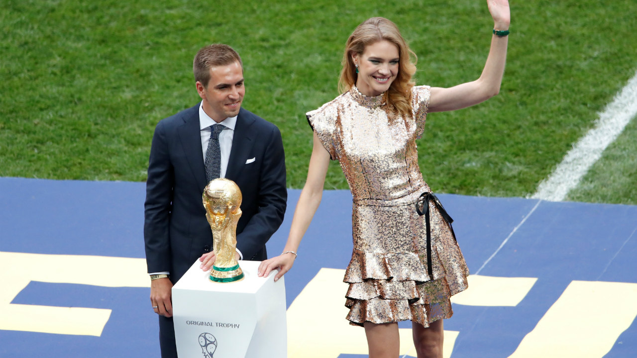 German football legend, and captain of the team that won the previous tournament, Phillip Lahm, presented the World Cup trophy before the game. (Image: Reuters)