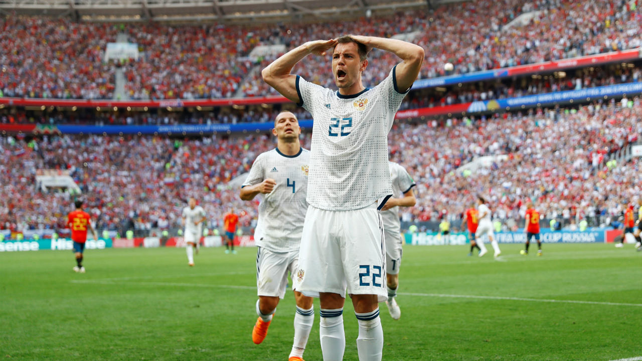 Dzyuba's Salute | Artem Dzyuba came off the bench in the 70th minute of Russia's opening game and scored his side's third goal within 60 seconds. Impressed by the feat, Russia manager Chercheshov saluted his player. Dzyuba returned the compliment when he scored against Egypt and Spain. (Image: Reuters)