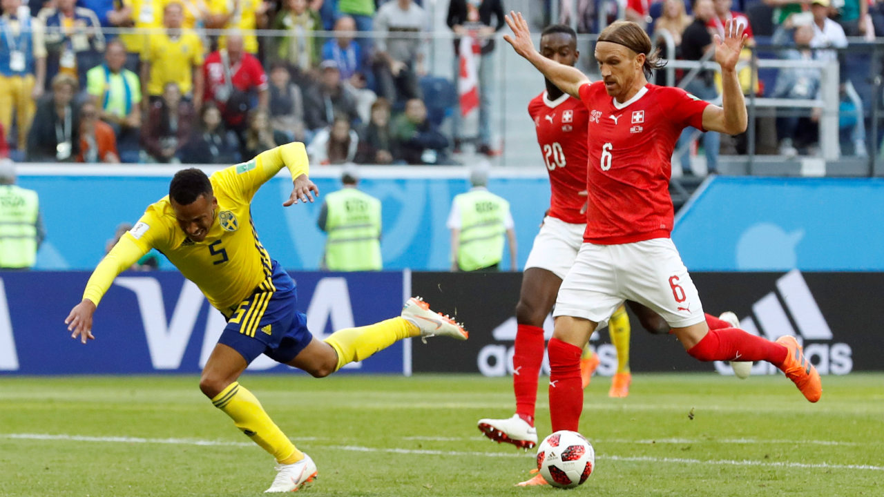 In the dying minutes of the game, Lang fouled Olsson of Sweden at the edge of the Swiss penalty box. He received a straight red card as there Switzerland saw their hope fade. (Image: Reuters)