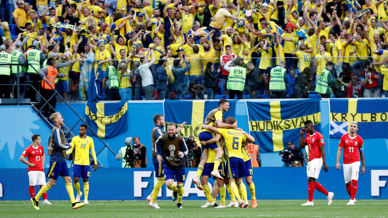 Swedish players and fans celebrate their qualification into the quarter finals. (Image: Reuters)