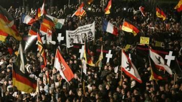Around 25,000 protest immigration stance of Angela Merkel's Bavarian allies