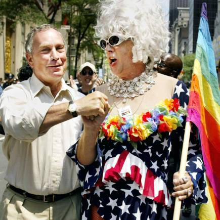 New York Mayor Michael Bloomberg greets Gilbert Baker as they take part in the annual Gay Pride parade in New York City, June 30, 2002. (Image: Reuters)
