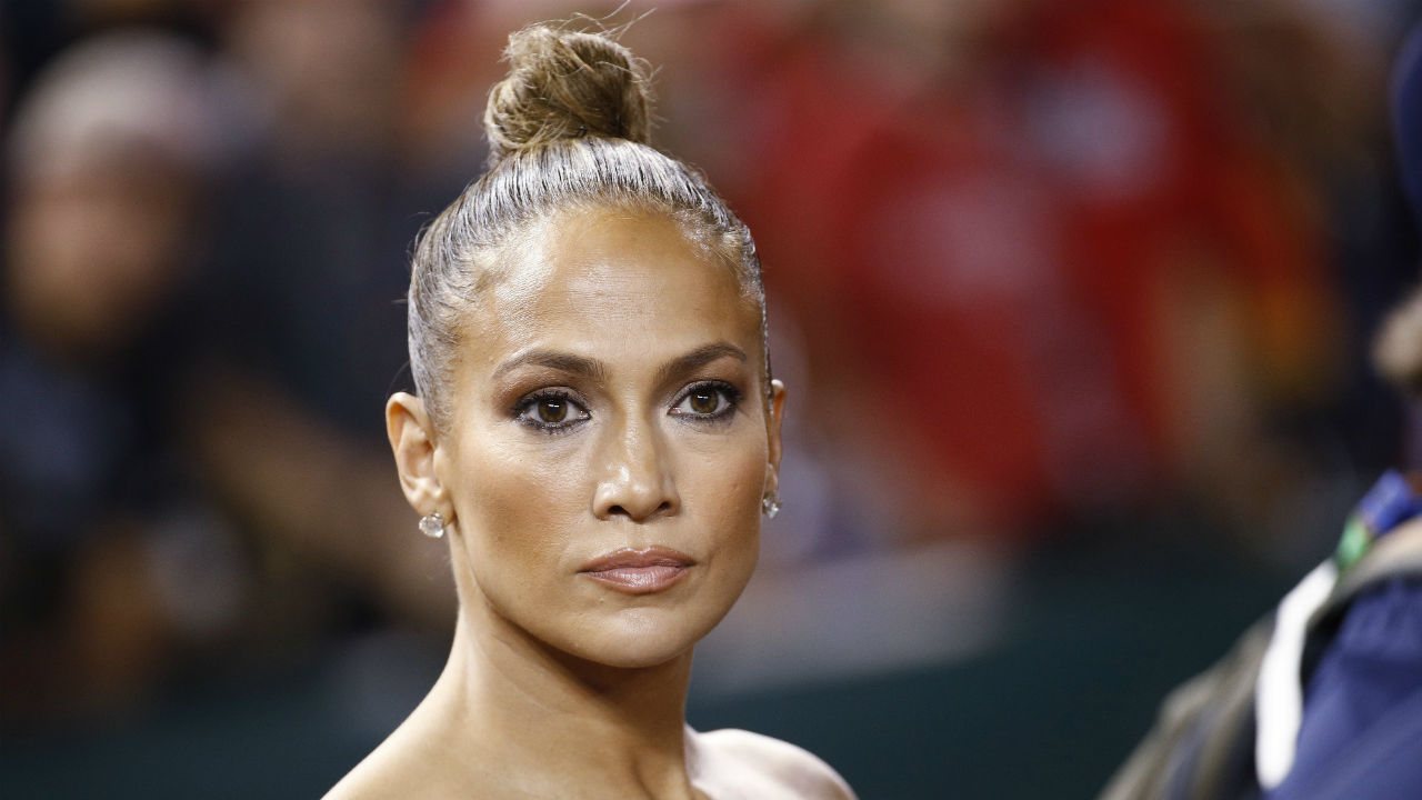 Entertainer Jennifer Lopez stands on the warning track after the Major League Baseball All-star Game, in Washington. (AP/PTI)