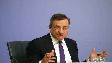 Draghi dials back QE in his last salvo; trade war and low inflation rankle investors