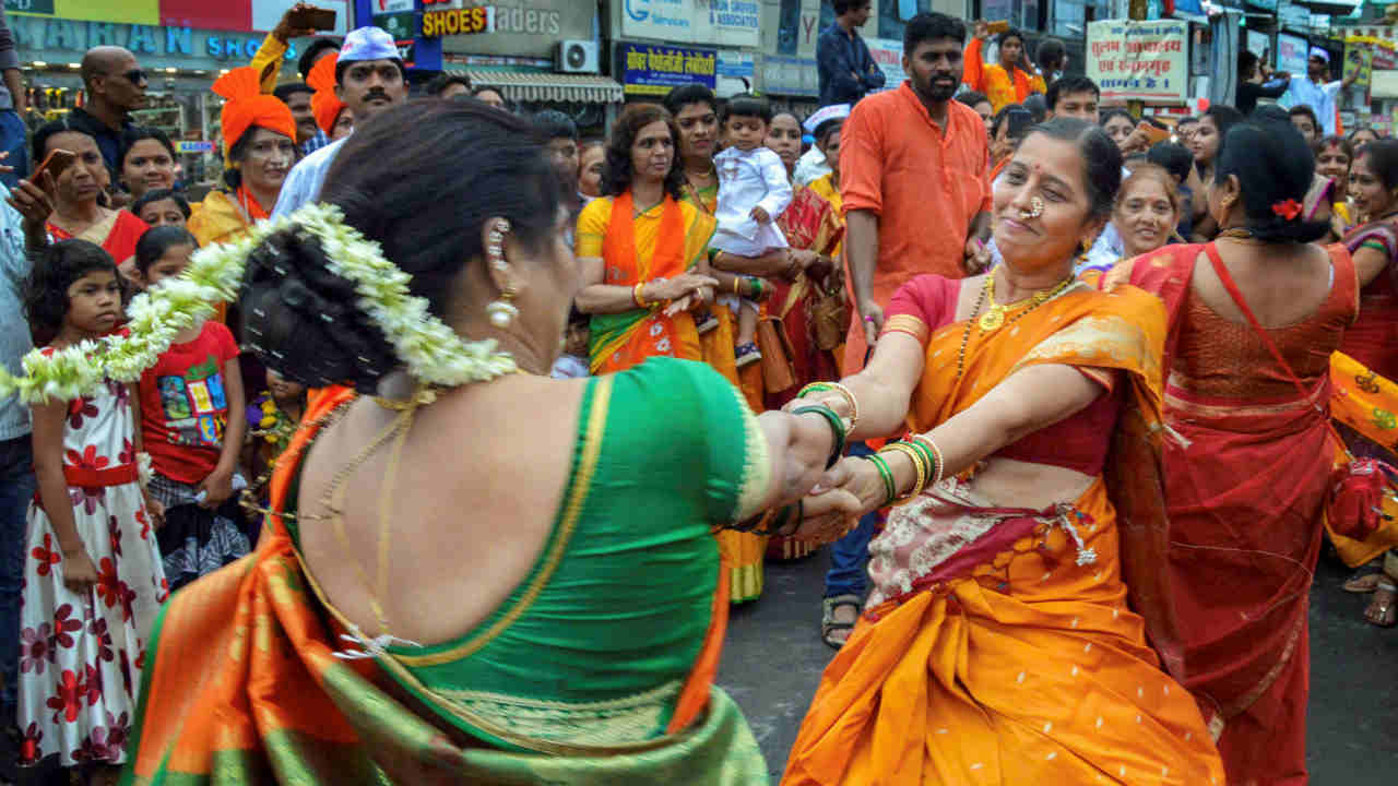 Devotees participate in a 'Dindi' procession of Lord Vitthal on the occasion of 'Ashadi Ekadashi' at a temple, in Jabalpur. (PTI)