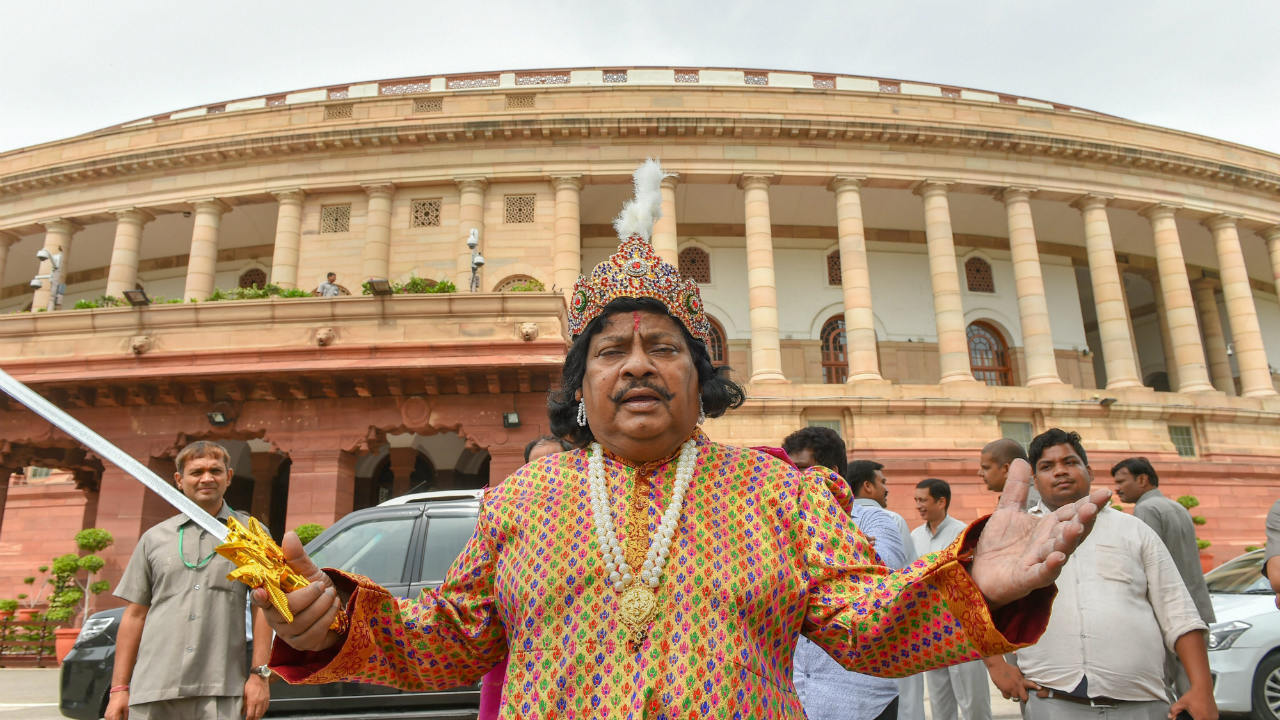 Telugu Desam Party (TDP) MP Naramalli Sivaprasad protests for the special status to the state of Andhra Pradesh, during the Monsoon session of Parliament, in New Delhi. (Image: PTI)