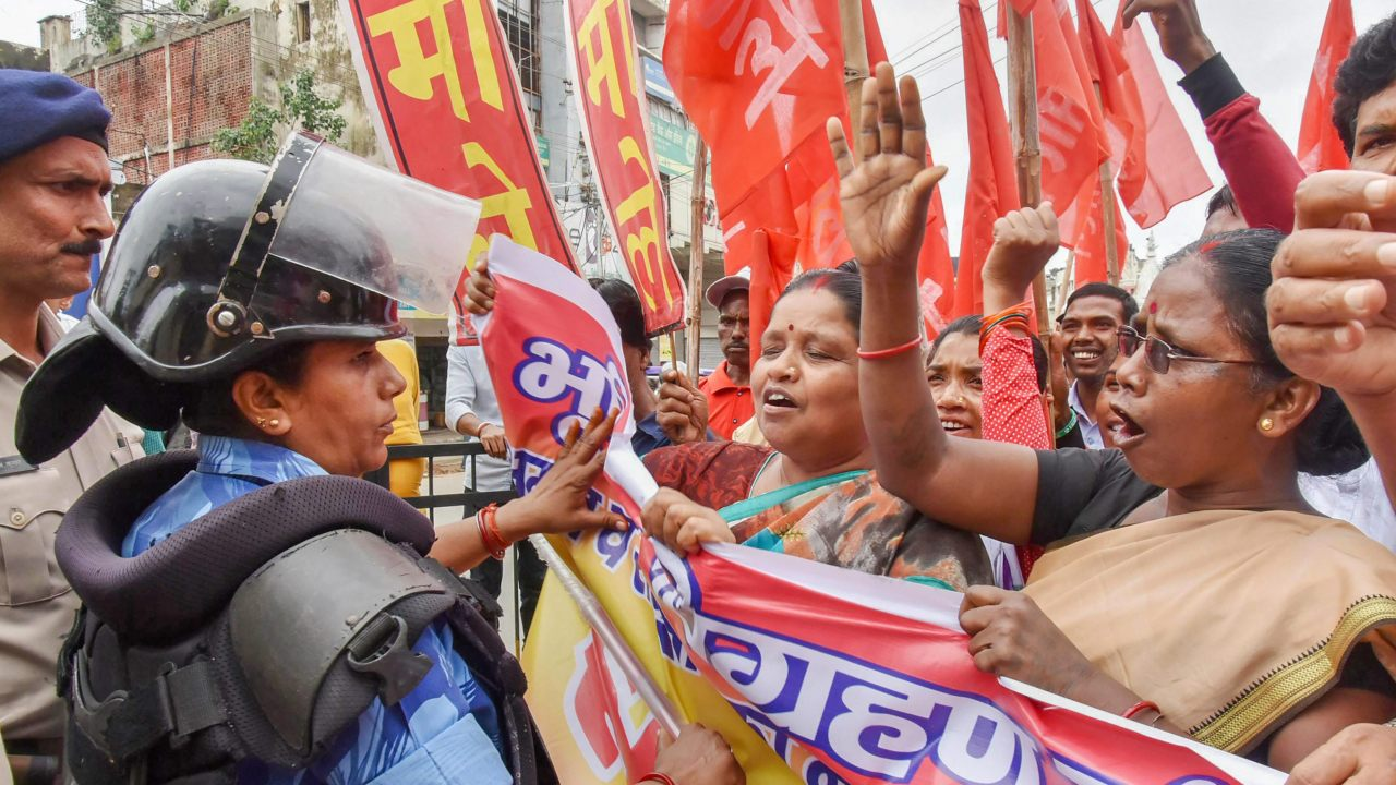 """Police stop Communist Party of India (Marxist-Leninist) activists who were protesting during 'Jharkhand Bandh' called by all opposition parties over the """"Land Acquisition Bill"""", in Ranchi, Jharkhand. (Image: PTI)"""