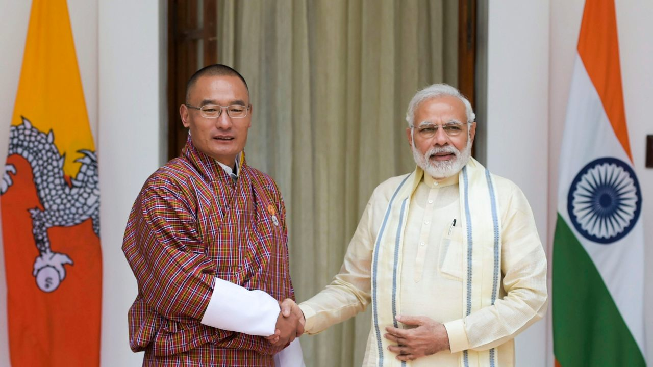 Prime Minister Narendra Modi shakes hands with Bhutanese Prime Minister Dasho Tshering Tobgay before their meeting at Hyderabad House in New Delhi. (Image: PTI)