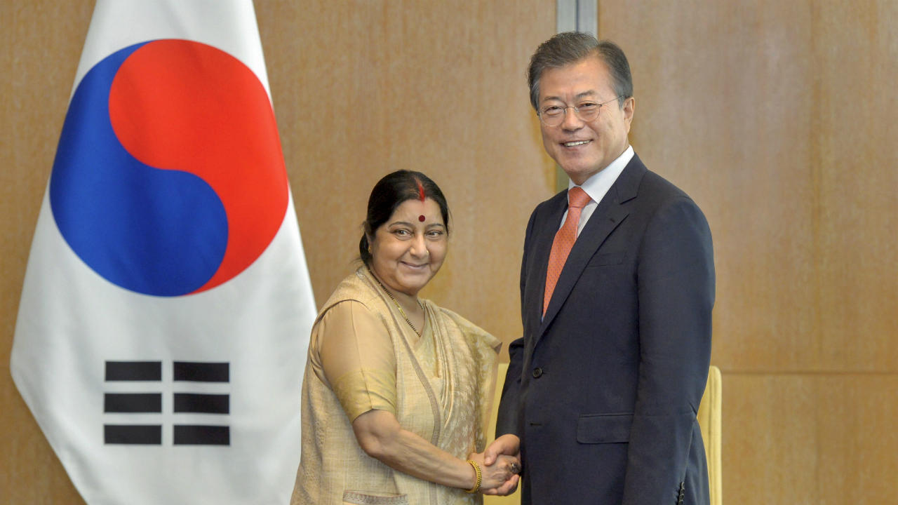 External Affairs Minister Sushma Swaraj and South Korean President Moon Jae-in shake hands at a meeting, in New Delhi on Monday. (PTI)