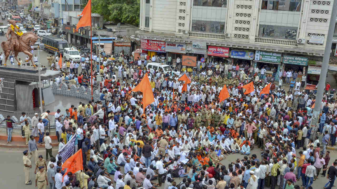Maratha community members block the road during a protest against the government demanding reservation for Marathis, in Solapur. (Photo: Reuters)