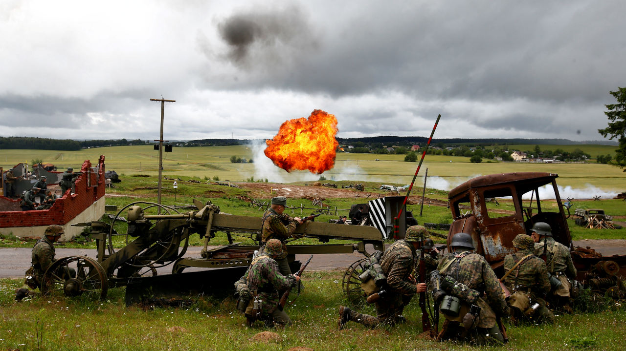 "Military enthusiasts take part in a re-enactment of a World War II battle on the eve of Independence Day at the ""Stalin Line"" memorial near the village of Goroshki, Belarus. (Image: Reuters)"