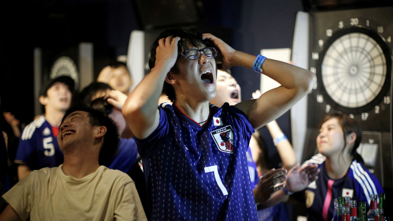 Japanese fans react after the second goal by Belgium as they watch a broadcast of the 2018 FIFA World Cup Round of 16 match at a sports bar in Tokyo, Japan. (Image: Reuters)