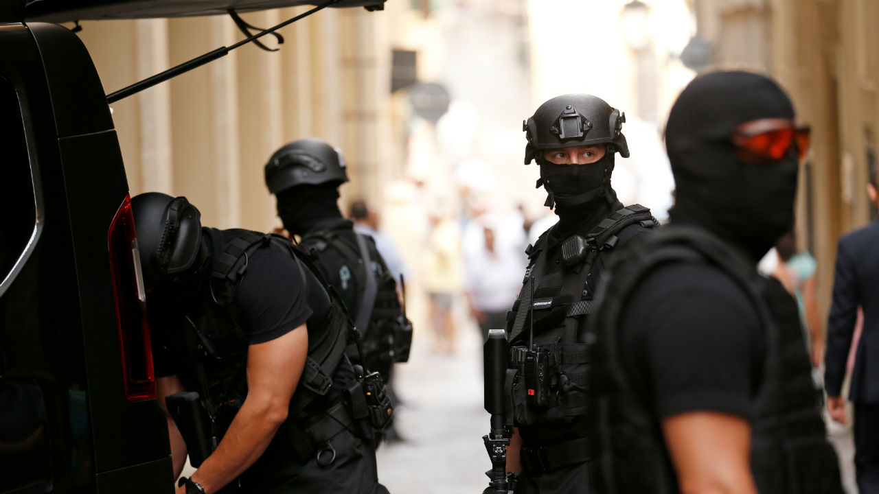 Armed police officers of the Malta Police Special Intervention Unit provide security whilst three men, accused of the assassination of anti-corruption journalist Daphne Caruana Galizia, attend the continuation of the compilation of evidence at the Courts of Justice in Valletta, Malta. (REUTERS)