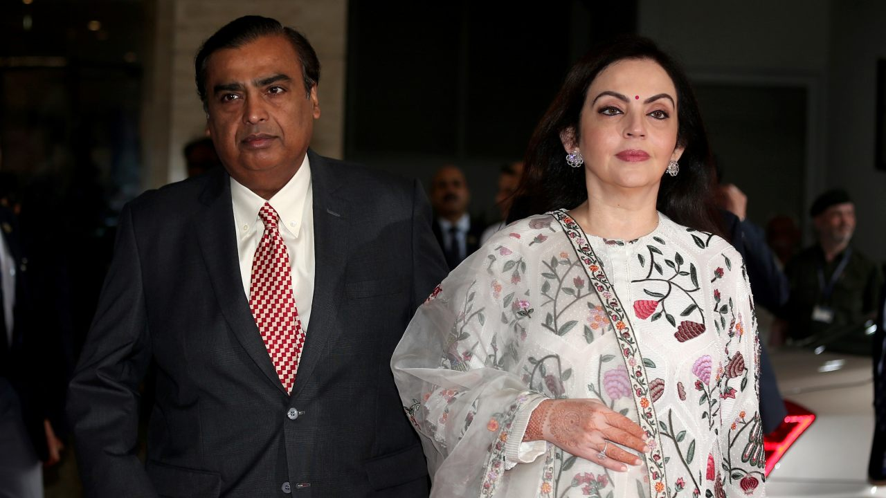 Mukesh Ambani, Chairman and Managing Director of Reliance Industries, arrives with his wife Nita Ambani to address the company's annual general meeting in Mumbai. (Image: Reuters)